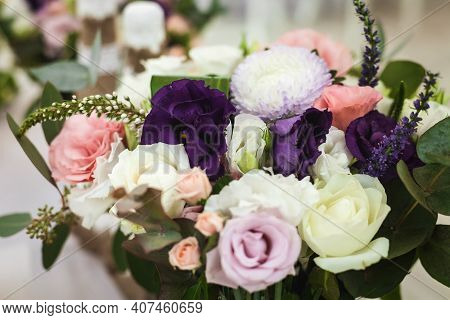 Beautiful Bridal Bouquet Including White, Pink, Purple Flowers And Green Florets Standing On A Festi