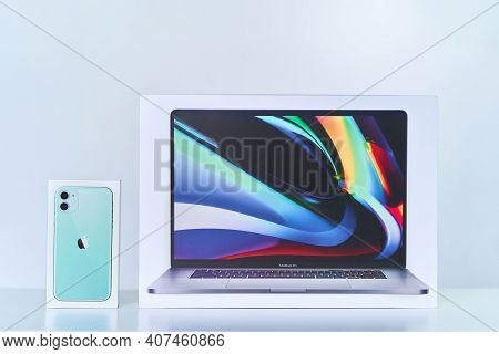 Boxes Of Mint Green Iphone 11 With Dual Camera And 16 Inch Macbook Pro Of 2019 Release. Apple Gadget