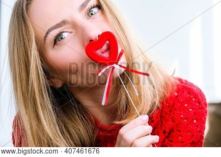 Young Blonde Girl In Red Sweater Holding Red Hearts Showing Emotions. Taking Selfie. Video Chat. Lov