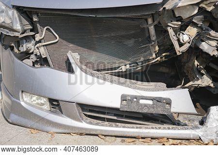 Crashed Damaged Broken Car. Automobile Crash Accident