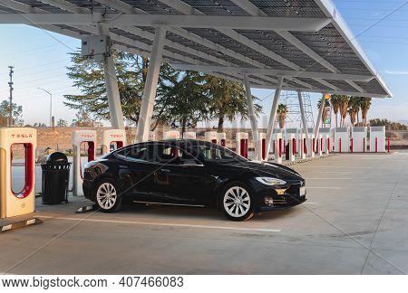 Firebaugh, Usa - January 21, 2021: Black Electric Luxury Tesla Model S 75d Car At A 250 Kw Superchar