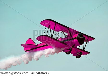 Pink Retro Airplane Biplane Isolated On Sky Background. Fashion Vintage Old Airplane Fly & Female Pi