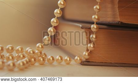 Golden Pearls Glitter Necklace Gift Jewelry For Women. Beautiful Bright Luxury Necklace Background A