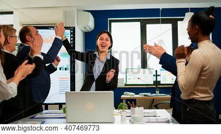 Happy Diverse Businesspeople Designers Giving High Five During Team Corporate Brainstorm Receving Go