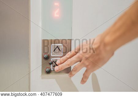 Hand Finger Press Button In Elevator With Virus. Covid-19 Or Coronavirus In The Elevator Button. But