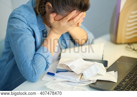 Sad Woman Holding The Bills To Calculate In Living Room At Home. Expenses, Account, Taxes, Home Budg