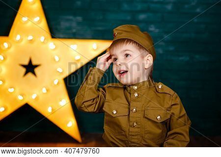 Army Thee Kid. Little Patriot. Young Soldier. Boy Playing Soldier. Portrait Of Happy Young Boy In Ca
