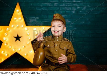 Funny Smiling Preschooler Boy In Military Uniform. Young Soldier. Little Patriot. Army Thee Kid. Boy