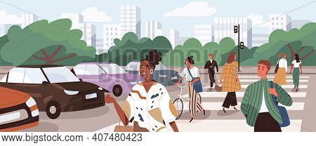 Crowd Of People Crossing Road At Crosswalk. Pedestrians And Cyclists Walking The Street On Zebra At
