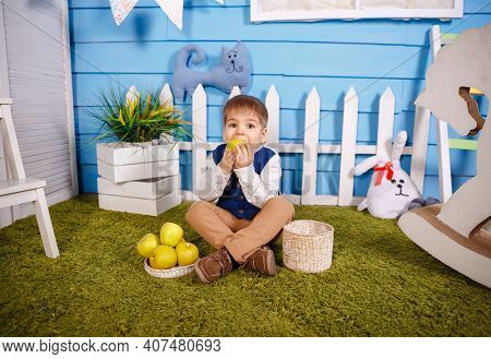 Funny Blonde Boy Eating Apple At Home. Boy Eating Healthy Food. Happy Caucasian Child Eating And Bit