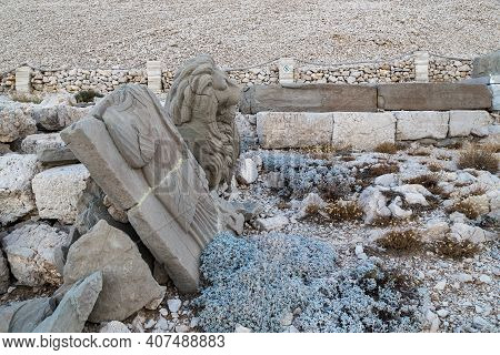 Nemrut Dag, Turkey - October 9, 2020: These Are The Ancient Ruins Of A Lion Sculpture And A Stele In