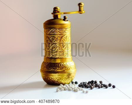 Pepper Spice Or Salt Grinder Mill On White Background. Golden Vintage Grinder Mill For Pepper, Salt,