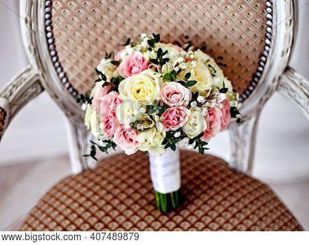 Vintage Wedding Bouquet Pink White Rose Flowers On Wooden Chair. Wedding Bouquet Of Flowers Pink & W