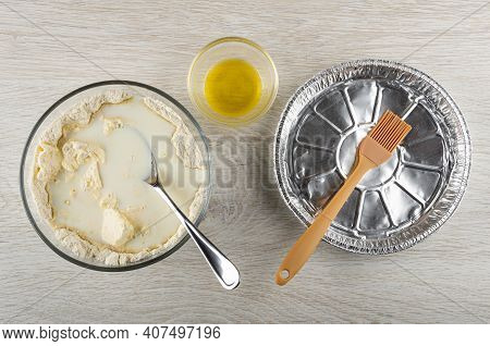Spoon, Blend Of Margarine, Flour, Milk In Transparent Bowl, Oil In Bowl, Silicone Pastry Brush In Al