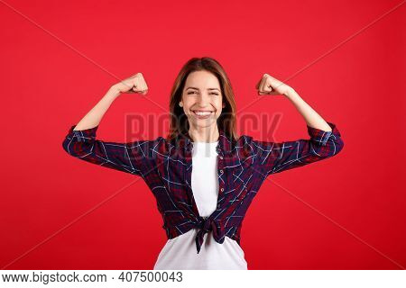 Strong Woman As Symbol Of Girl Power On Red Background. 8 March Concept