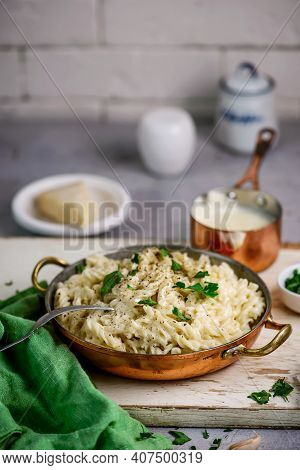 Alfredo Pasta Sauce With  Garlic And Parmesan .style Rustic.selective Focus
