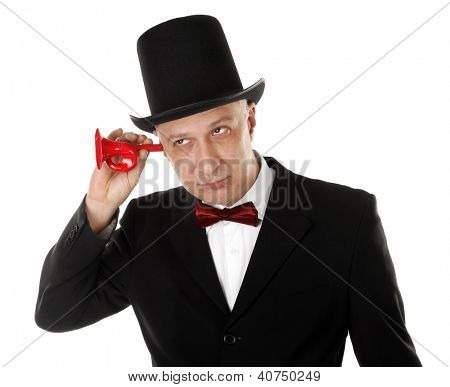 Rich man is listening in something with ear trumpet