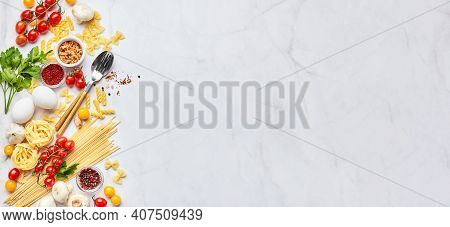 Food Background With Place For Text, With Different Kinds Of Pasta, Tomatoes, Herbs, Mushrooms, Eggs