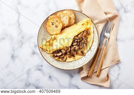 Omelet With Champignons In Plate On Marble Background. Frittata - Italian Omelet For Breakfast Or Lu