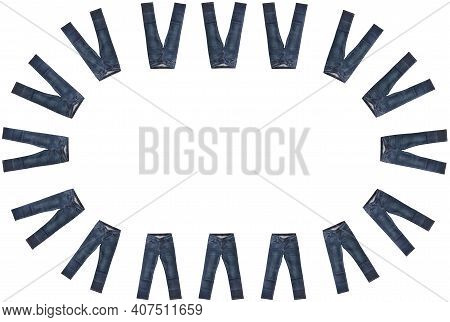 Sixteen Pairs Of Dark Blue Jeans Isolated On White Background. Close Up Shot. Jeans Encircle Copy Sp