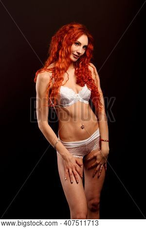 Studio Portrait Of Young Attractive Woman Model With Redhead Long Curly Hair, In Underwear.