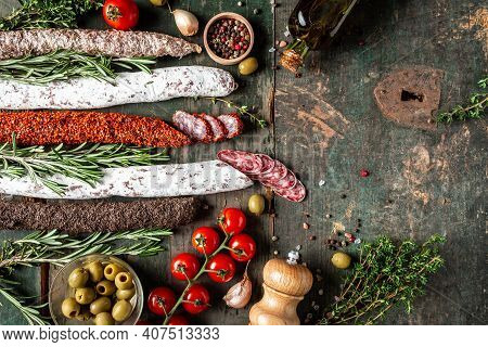 Spanish Dry Cured Sausages Salami, Fuet And Chorizo On A Wooden Background. Banner, Catering Menu Re