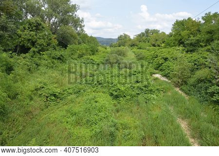 The Dried Up River Bed Of The Torrente Malina In Rural Friuli-venezia Giulia, North East Italy, Near