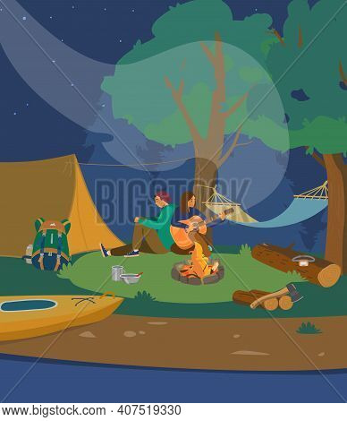 Young Couple Sitting With Guitar Near Night Campfire. Night Camp Site Near River. Camping Scene. Car