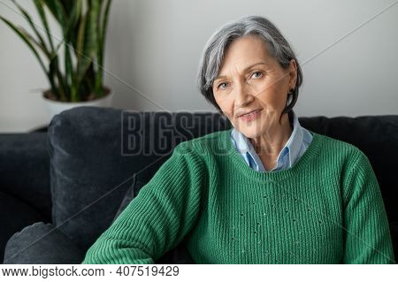 A Portrait Of A Charming Beaming Old Lady Posing And Looking At The Camera, Gray-haired Senior Matur