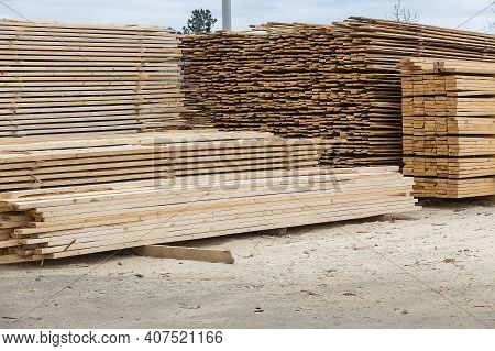 Bundles Of Boards And Bars Outside. Sale For Construction