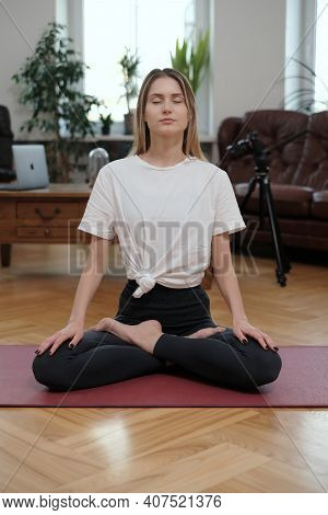 Portrait Of Female Athlete Which Cares About Her Health And Does Yoga Meditating With Closed Eyes In