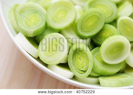 bowl full of fresh leek - fruits and vegetables