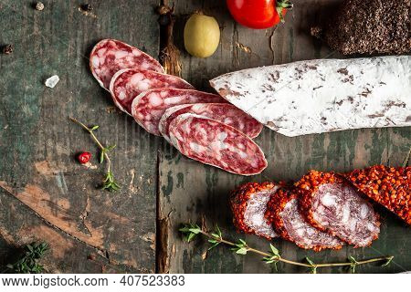 Mature Air Dried Sausage, Fuet Fresh And Sliced On Wooden Board Closeup. Spanish Traditional Sausage
