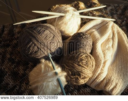 Balls Of Yarn, Knitted Clothes, Knitting Needles And Crochet Hooks. Knitting As A Hobby. Brown, Beig