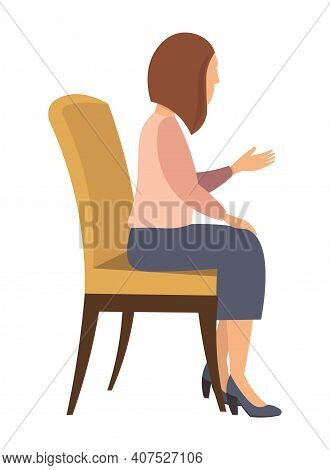 Woman Sitting On The Chair And Pointing On Something By Hand. Side View. Women At Home. Female Chara