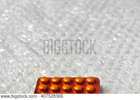 Trendy Modern Minimalistic Background Of Orange Pills Blister. Bubble Bag Background. Packages Of Ta