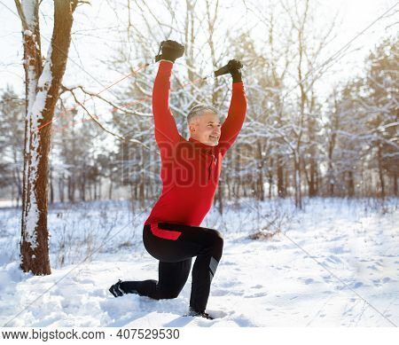 Outdoor Functional Fitness Workout Concept. Active Mature Man Using Bodyweight Resistance Straps, Do