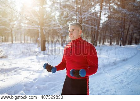 Outdoor Winter Sports Concept. Strong Senior Man Working Out With Dumbbells, Training His Muscles At