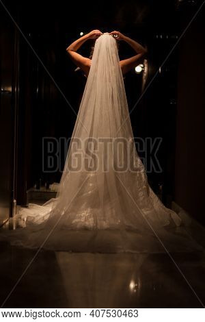 Beautiful Bride In Luxurious Wedding Dress In A Dark Hall. Beautiful Bride With Stylish Make Up And