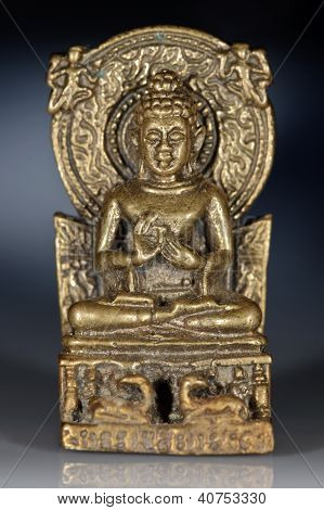 Bronze figurine of sitting Buddha