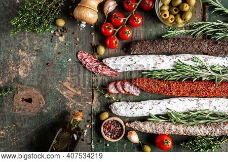 Set Of Spanish Sausages And Dry Cured Meat Chistorra, Chorizo, Salchichon, Fuet, Olives, Rosemary, C