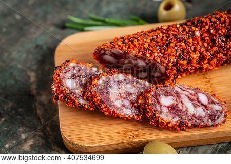 Sliced Salami, Salami Sausages Chorizo Made With Paprika And Garlic On Cutting Board. Food Recipe Ba