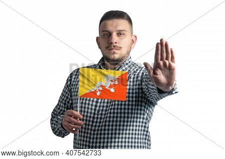 White Guy Holding A Flag Of Butane And With A Serious Face Shows A Hand Stop Sign Isolated On A Whit