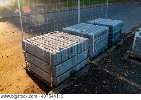 Road Repairs. A Few Stacks Of Curbs Prepared For Laying. High Quality Photo