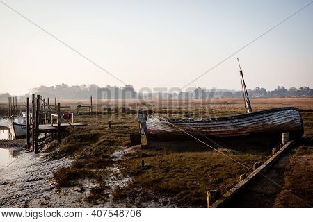 Old Boat At Thornham Old Harbour, Norfolk, England In Early Morning Light