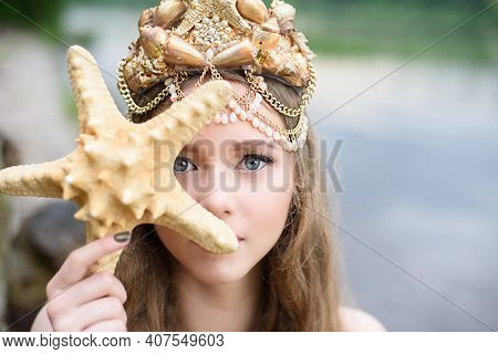 Fantasy Woman Real Mermaid With Trident Myth Goddess Of Sea With Golden Tail Sitting In Sunset On Ro