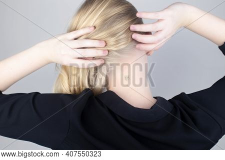 The Woman Shows His Neck With A Chip Implanted. The Concept Of Chipping And Implantation Of Electron