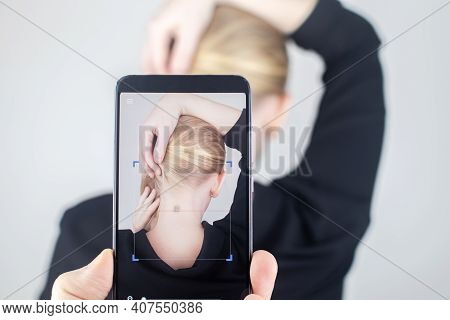 The Woman Shows His Neck With A Chip Implanted Which Is Read Or Scanned By A Special Device. Concept