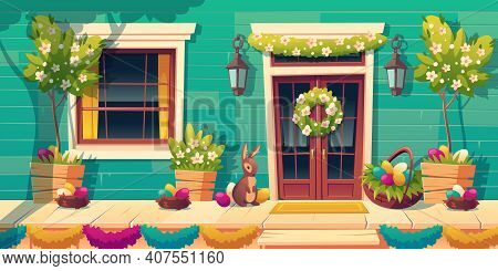 House Facade With Easter Decoration On Door And Wooden Porch. Colored Eggs In Nests, Cute Bunny And