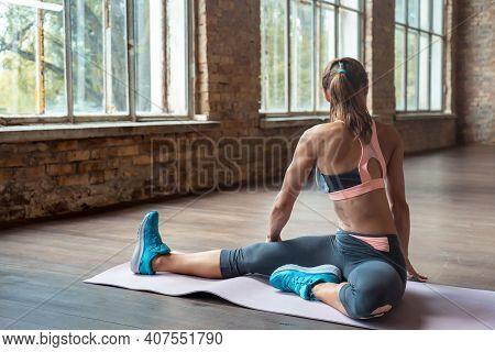 Fit Young Sporty Woman Bodybuilder Wear Sportswear Warm Up Stretching Body Muscles Sit On Mat In Stu